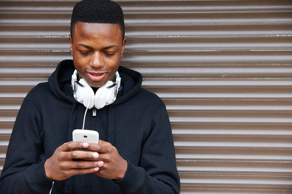 Image result for Black youths on their phone